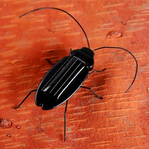 New Solar Power Energy Cockroach Fun Gadget Kids Children Cockroack Toy Gift (Color: Black) Electronic Toy