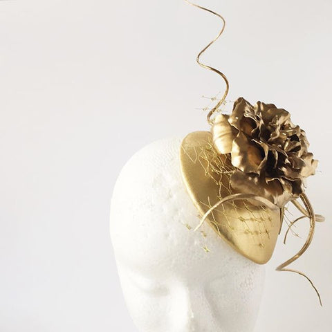 Gold leather flower quill and veil by Maker Millinery