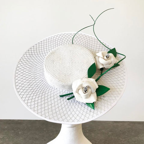 White and green percher boater with silver crinoline and leather flowers by Maker Millinery