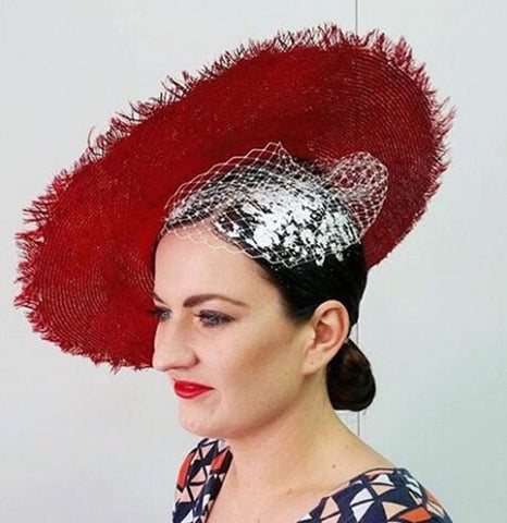Red straw hat with white veil and foiled hair by Maker Millinery and Mesmerised Hair