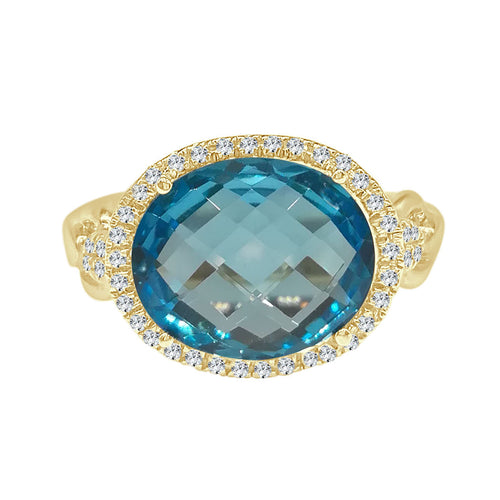 Oval Blue Topaz Ring With Diamond Halo