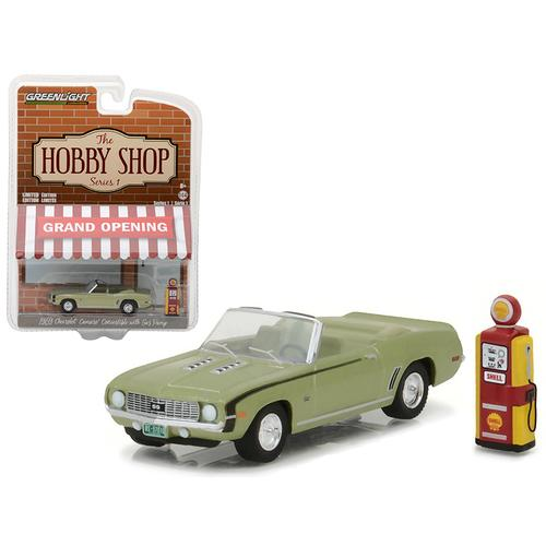 "1969 Chevrolet Camaro Convertible Green with Vintage Gas Pump ""The Hobby Shop"" Series 1 1/64 Diecast Model Car by Greenlight"