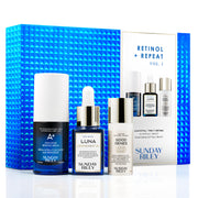Retinol+Repeat kit contents in front of the cobalt blue textured iridescent box. Kit includes A+ High Dose Retinoid Treatment, Luna Night Oil, and Good Genes Lactic Acid.