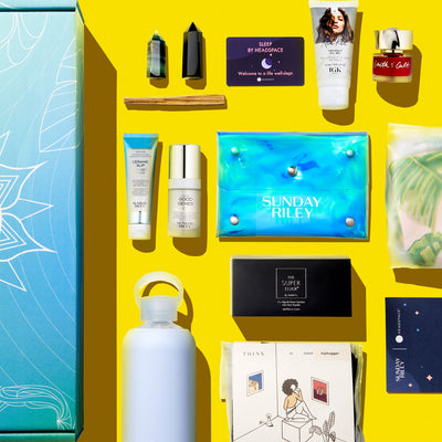 flat lay of subscription box products on bright yellow background,
