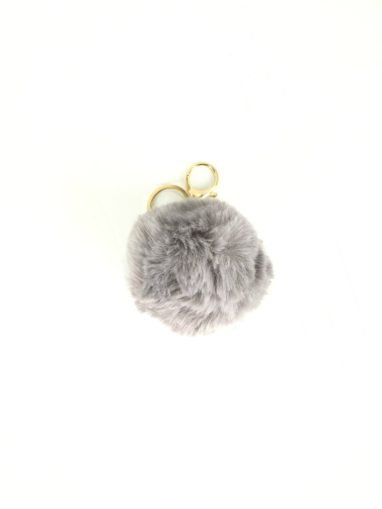 POMPOM PURSE CHARM IN GREY
