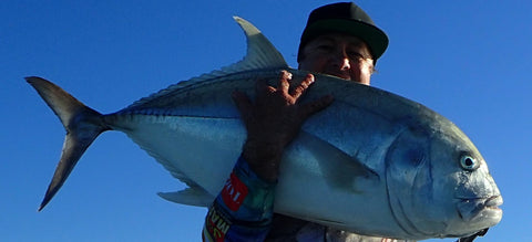 Photo of Gavin Miles with a Giant Trevally caught using an Old Dog Lures by Dave Killalea