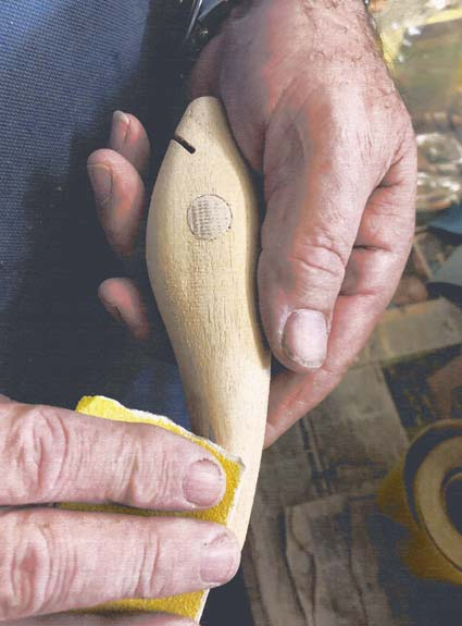 A Jew Dog 150mm Fishing Lure being hand sanded by Dave Killalea prior to painting.