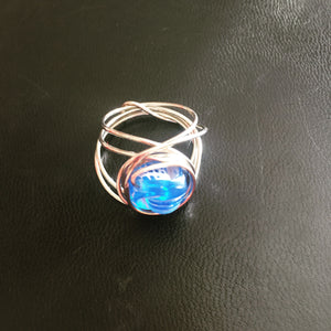 Wire wrapped ring with blue bead