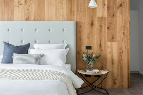 Grey bedhead with wooden feature wall