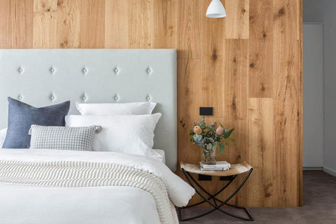 TRES bedroom with wooden wall