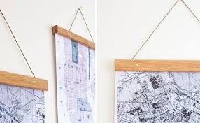 hangers are a cheaper option for hanging your world map but there are some risks