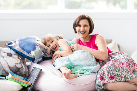 Mother and daughter laughing on a beanbag. Curious Kids' Science owner Rachel Brittliff