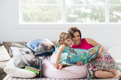 Mother and daughter reading How to Survive as a Shark