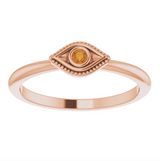Wild Tide| Curated Collection:  Front view of rose gold stack ring with orange citrine crystal eye. seeker_evil_eye_ring | Wild_Tide_Jewelry