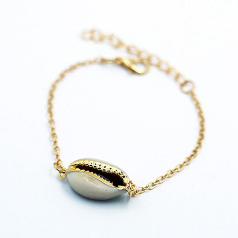 BEACH SHELL BRACELET WITH A GOLD PUKA BEAD