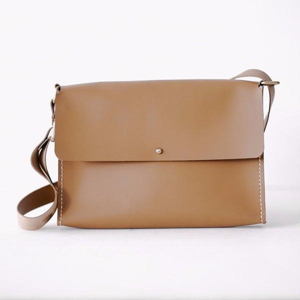 Reporter's Sling Bag in Brown