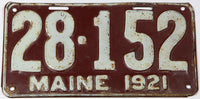 An antique 1921 Maine car license plate in very good minus condition