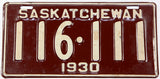 An antique New Old Stock 1930 Saskatchewan passenger car license plate in very good plus condition with the original mailing wrapper