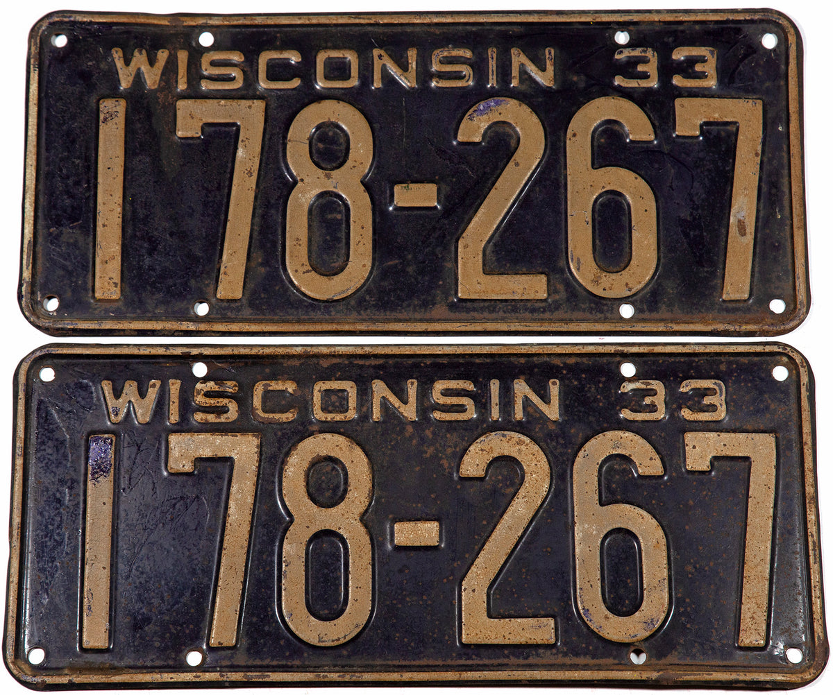 1933 Wisconsin car license plates in very good condition with bend