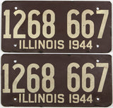 An antique pair of WWII 1944 Illinois car licenese plates with original mailing envelope