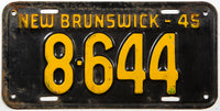 An antique 1945 New Brunswick passenger car license plate in very good minus condition