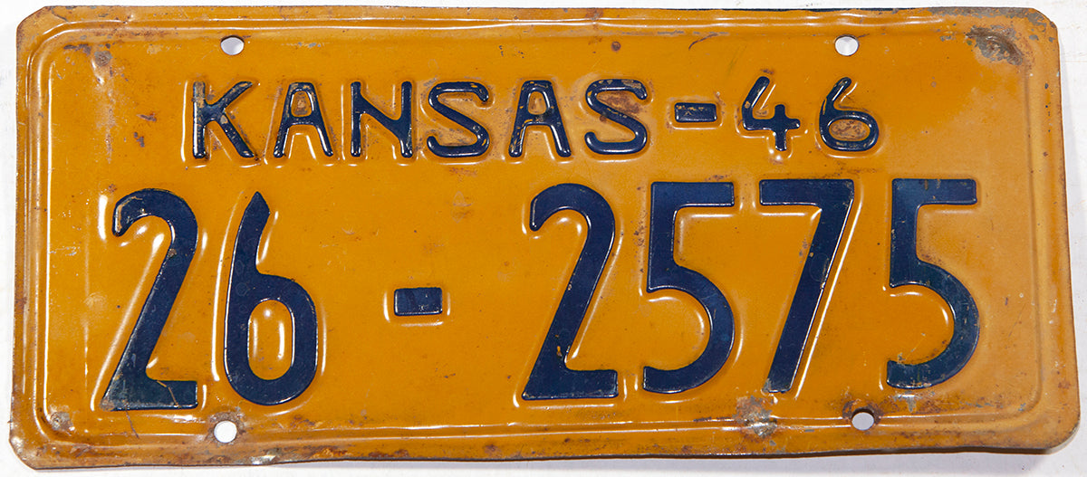 An antique 1946 Kansas Passenger Automobile license plate in very good plus condition with minor bends
