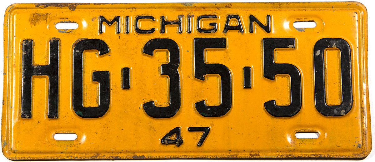 An antique 1947 Michigan car license plate in very good condition
