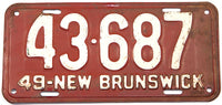 An antique 1949 New Brunswick passenger car license plate for sale at Brandywine General Store in very good condition