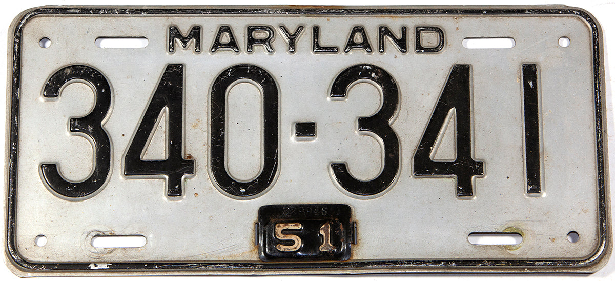An antique 1951 Maryland passenger car license plate in very good plus condition