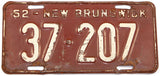 An antique 1952 New Brunswick passenger car license plate in very good minus condition