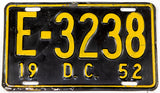 An antique 1952 District of Columbia passenger car license plate in very good condition with some bends
