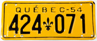 A vintage 1954 Quebec passenger car license plate in excellent minus condition with an extra hole
