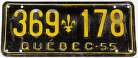 A vintage 1955 Quebec passenger car license plate in very good condition