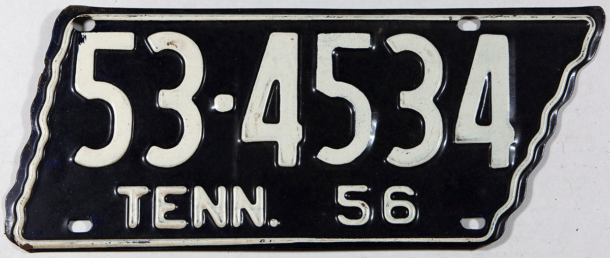 A much sought after 1956 Tennessee passenger car license plate which is shaped like the state of TN in very good plus condition