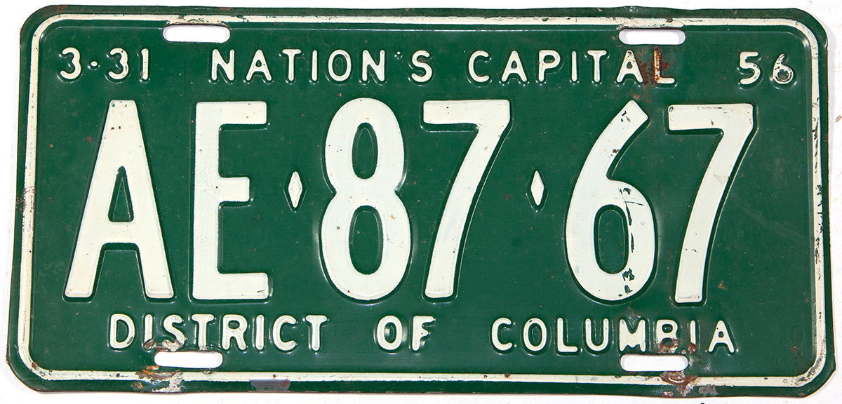 An antique 1956 Washington DC passenger car license plate in very good plus condition with some bends in the metal