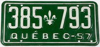A classic 1957 Quebec passenger car license plate in excellent minus condition