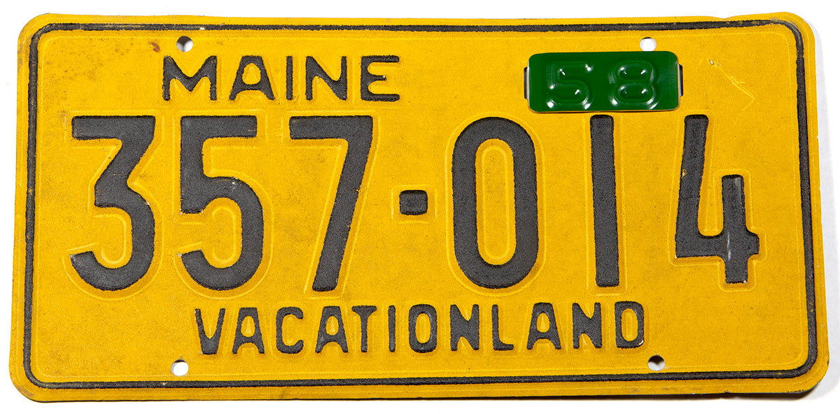 A classic 1958 Maine car license plate in excellent minus condition with green year tab
