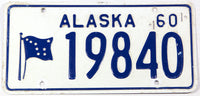 A classic 1960 Alaska passenger car license plate in very good plus condition