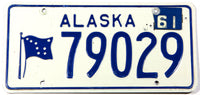 A classic 1961 Alaska passenger car license plate in excellent minus condition