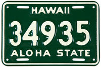 A 1961 to 1968 Hawaii Motorcycle license plate grading near mint