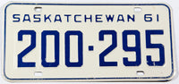 A classic 1961 Saskatchewan passenger car license plate in excellent minus condition