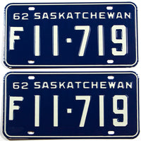 A classic pair of 1962 Saskatchewan Canada farm truck license plates in excellent plus condition with original wrapper