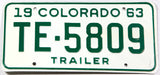 A vintage New Old Stock 1963 Colorado trailer license plate in excellent minus condition with the original wrapper