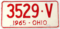 A classic 1965 Ohio passenger car license plate in very good plus condition