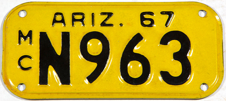 A 1967 Arizona motorcycle license plate in excellent minus condition