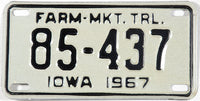 A 1967 Iowa Farm Market Trailer License Plate grading NOS Near Mint.