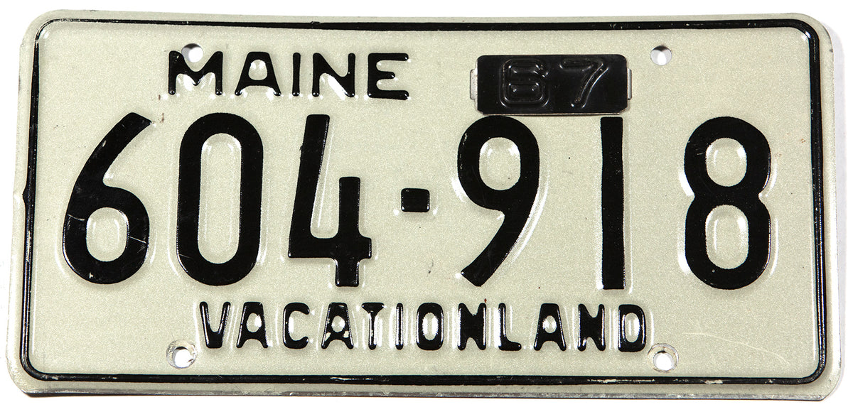 A classic 1967 Maine car license plate in excellent minus condition