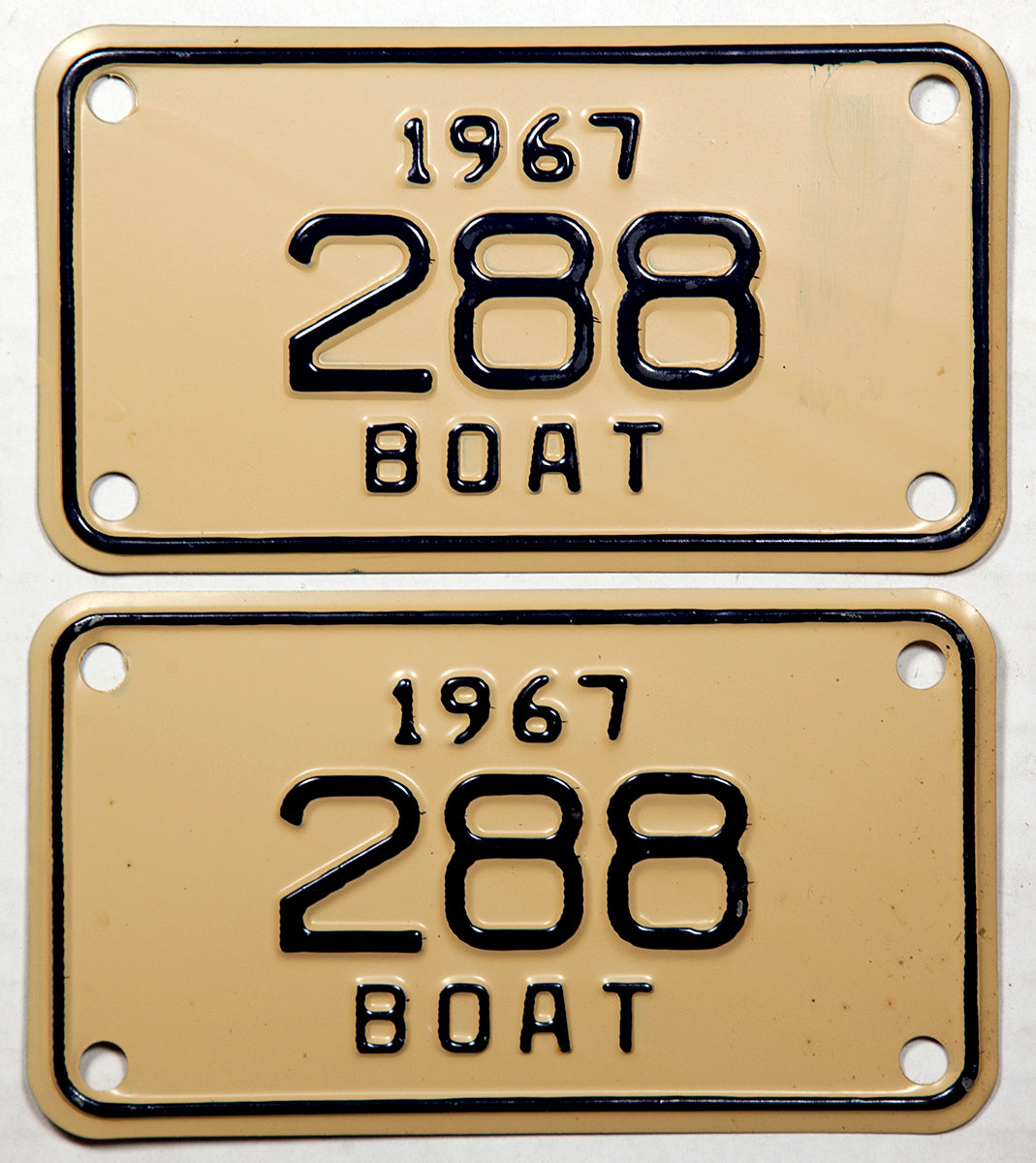 A pair of NOS 1967 Michigan Boat License Plates