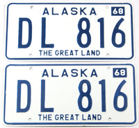 A pair of classic 1968 NOS Alaska dealer license plates in New Old Stock near mint condition with original mailing envelope