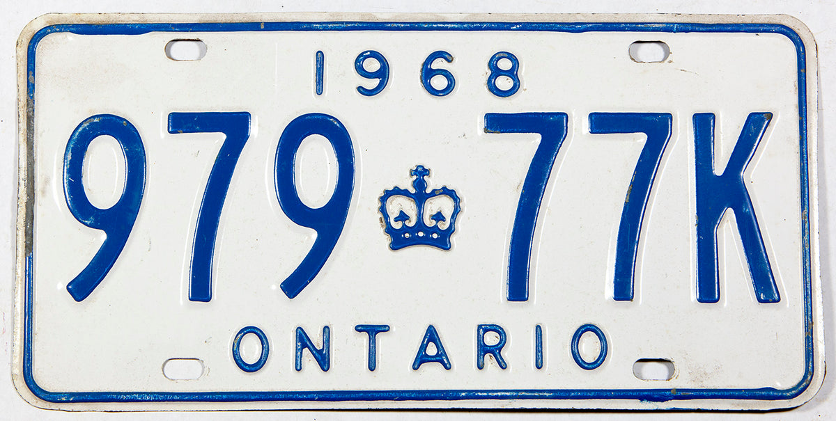 A 1968 Ontario Canada passenger car license plate in very good plus condition with bend